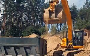 погрузка карьерного песка в транспорт